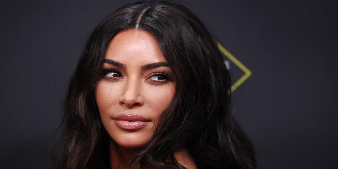 The photo of Kim Kardashian studying in a bikini that is rolling on social media
