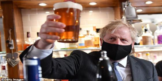 Boris Johnson enjoys his first pint after the shutdown