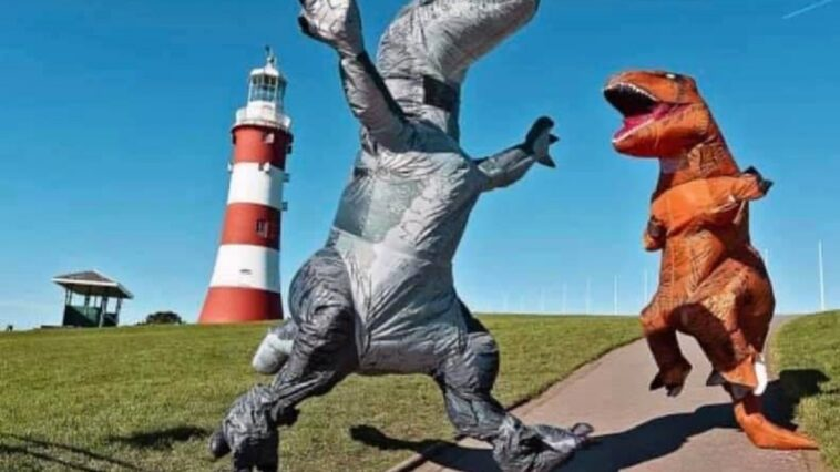 Woman Sets World Record for People Meeting in Dinosaur Costumes