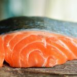 Farmed salmon is fed chemicals to turn the meat pink