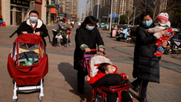 China allows couples to have up to three children