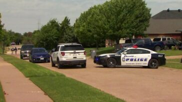A child was found dead in the middle of a Texas Dallas street Saturday