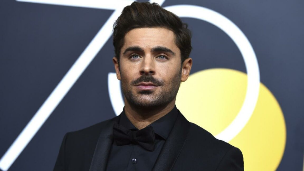 Zac Efron shows off his face in a new photo promoting his Netflix series