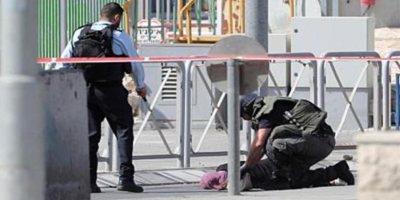 An Israeli guard shoots dead a Palestinian woman wielding a knife
