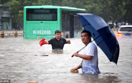 At least 12 dead in China's worst floods in 1,000 years