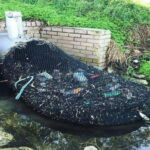 A netted drainage network retains plastics and debris in Australia