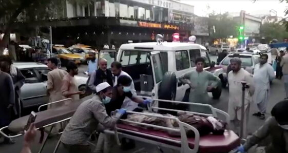 Dozens killed and injured in two blasts at Kabul airport