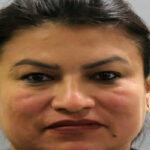 Woman arrested and charged with rape of 14-year-old boy