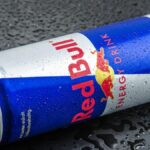 A teenager who drinks 12 cans of Red Bull a day was admitted to hospital after suffering heart cramps