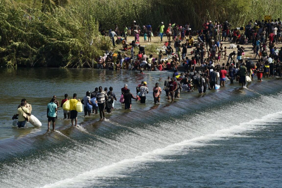Thousands of Haitian migrants camp out under a bridge in Texas