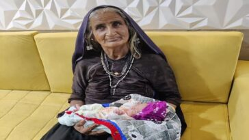 A 70-year-old woman becomes the world's second oldest mother as she welcomes her first baby into the world